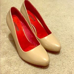 Unlisted nude patent pumps. Man made material